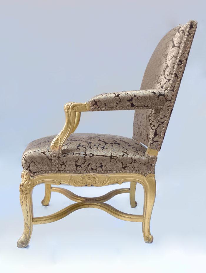 Paire fauteuils régence doré coté