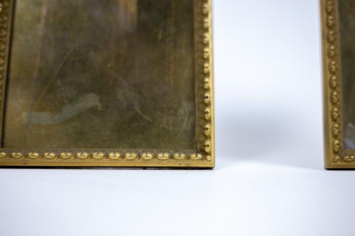 cadres bronze doré frise raies de coeur détail