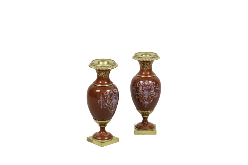 Pair of small vases in red porcelain and gilt bronze, circa 1900
