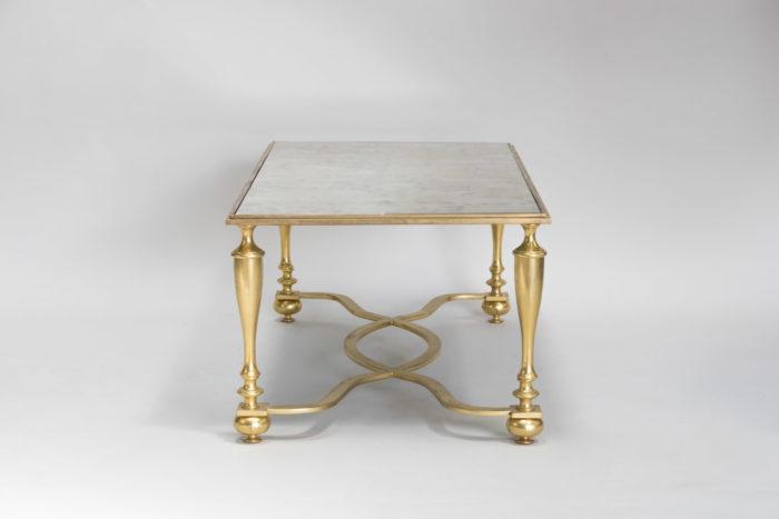 table basse bronze dore coté