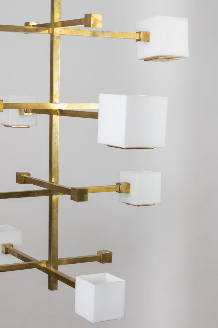 suspension laiton doré détail cubes en verre blanc