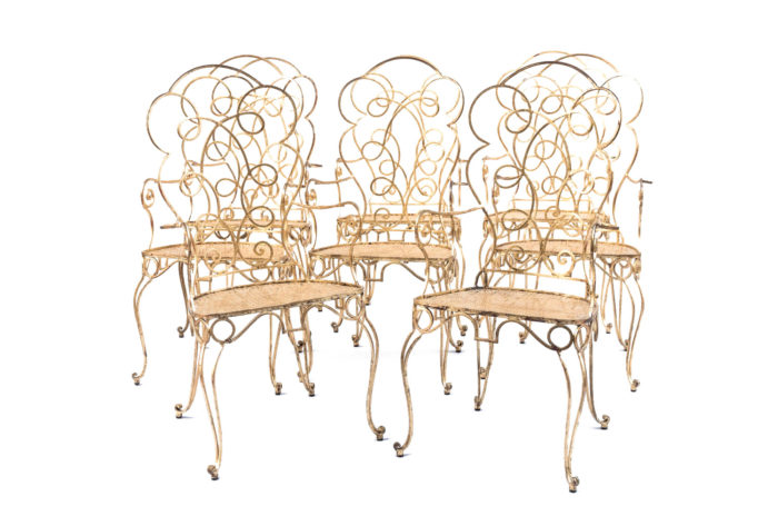 eight gilt wrought iron chairs