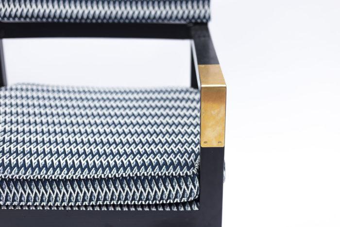fauteuil ployant laqué noir accotoir doré devant