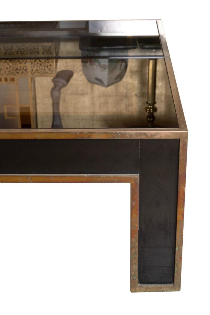 table basse noire et or côté détail plateau