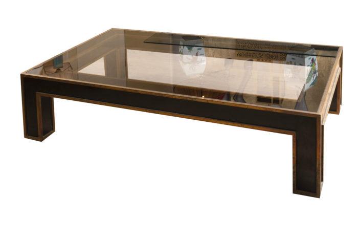 table basse noire et or dessus