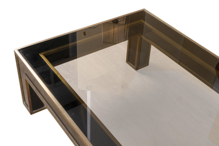 table basse noire et or dessus plateau verre