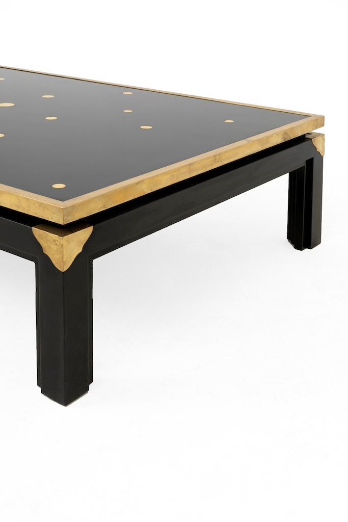 table basse noire et or côté baguette laiton doré