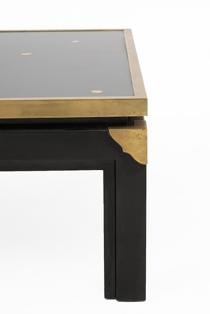 table basse noire et or coin pied