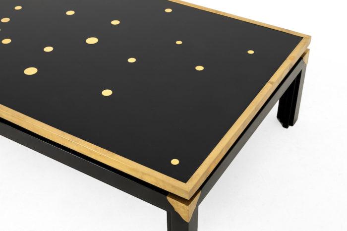 table basse noire et or dessus plateau droit