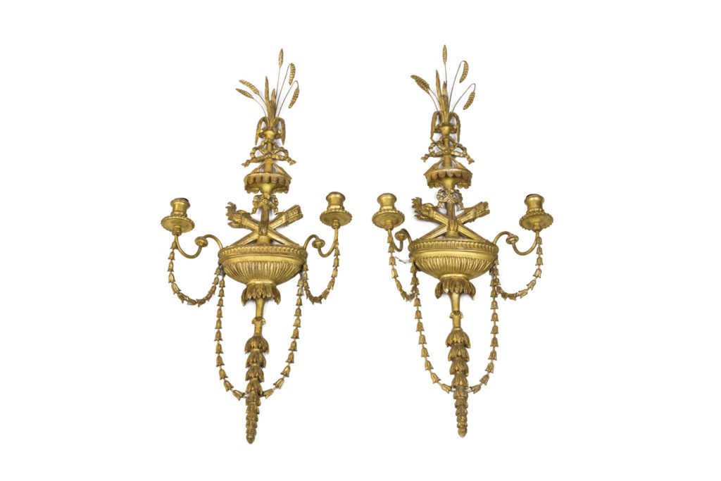 Pair of Adam style wall sconces in gilt stucco and metal, 1950's