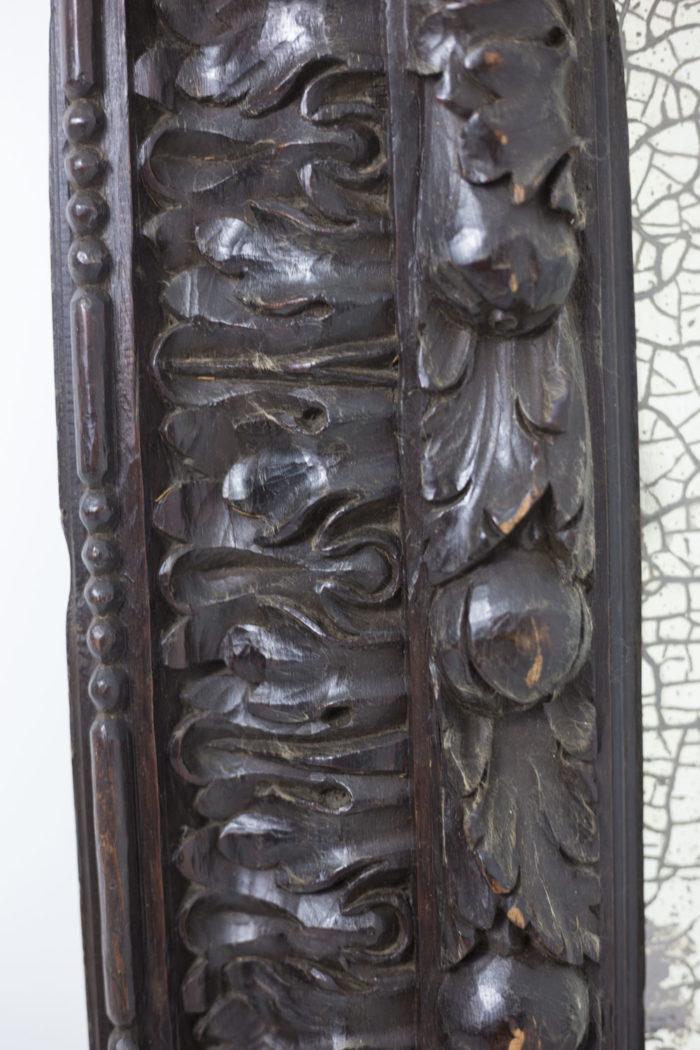miroir bois noirci sculpté feuilles