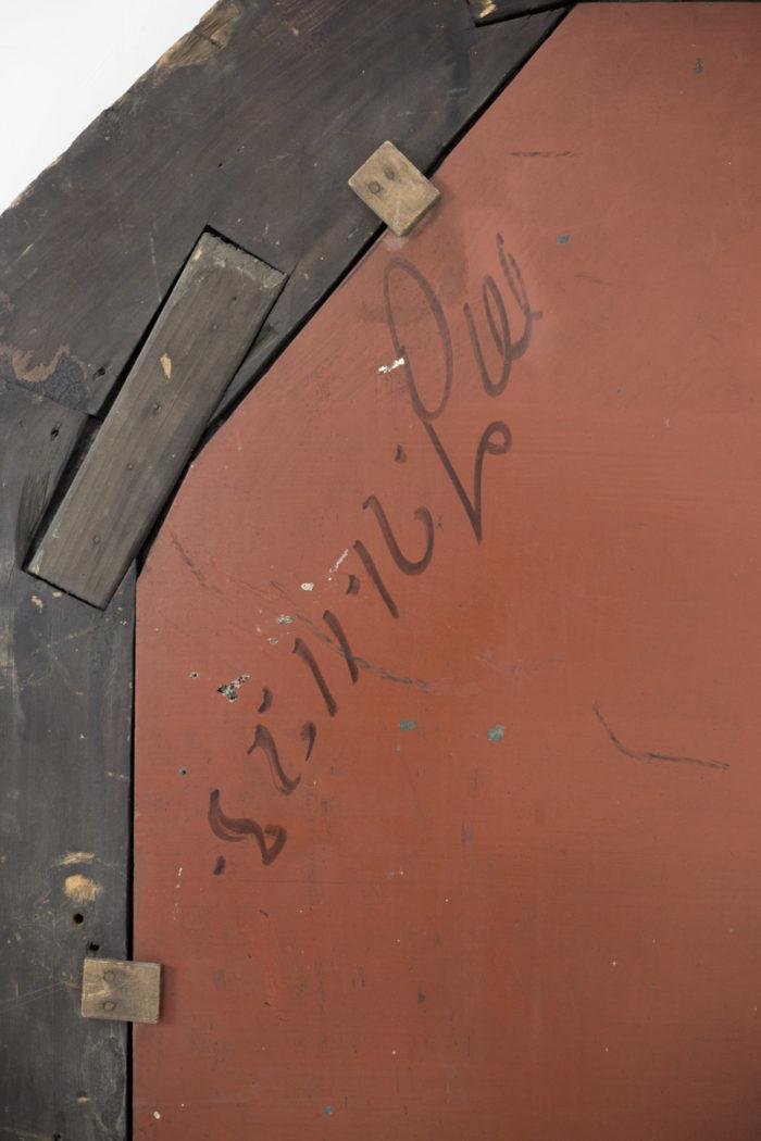 miroir octogonal bois noirci dos rouge écritures