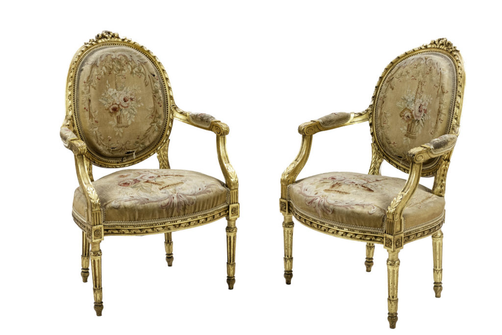 Pair of Louis XVI style armchairs in gilt wood, circa 1880