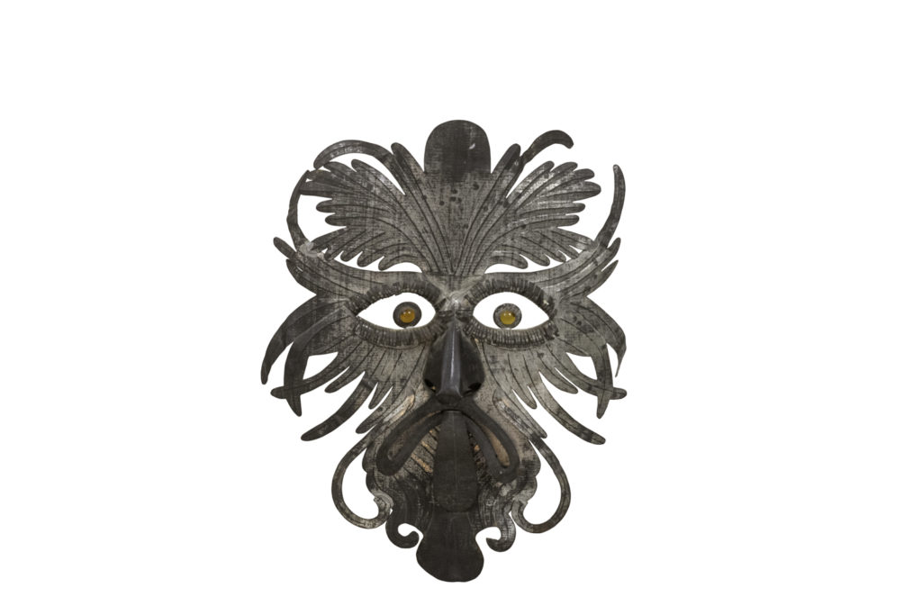 Grotesque mask in embossed silvered metal, 1970's