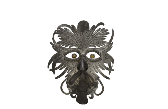 grotesque mask embossed silvered metal