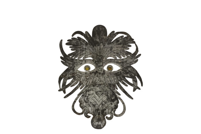 grotesque mask embossed silvered metal back
