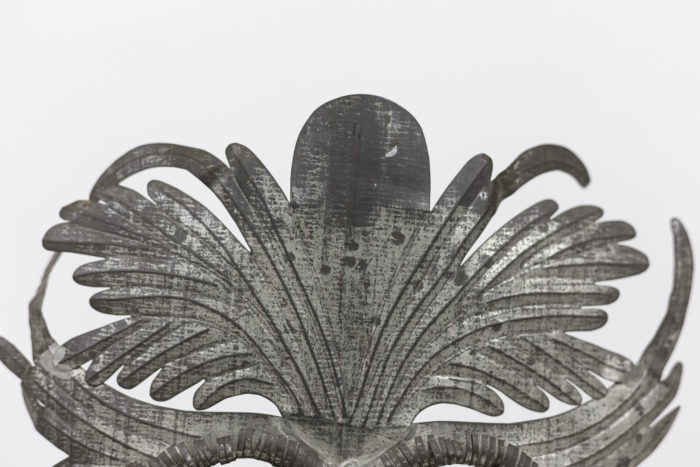 grotesque mask embossed silvered metal leaves