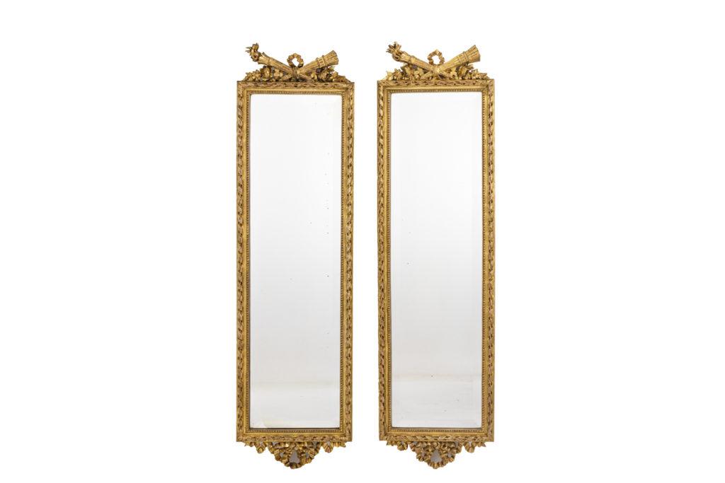 Paire de miroirs style Louis XVI en bois doré, circa 1880