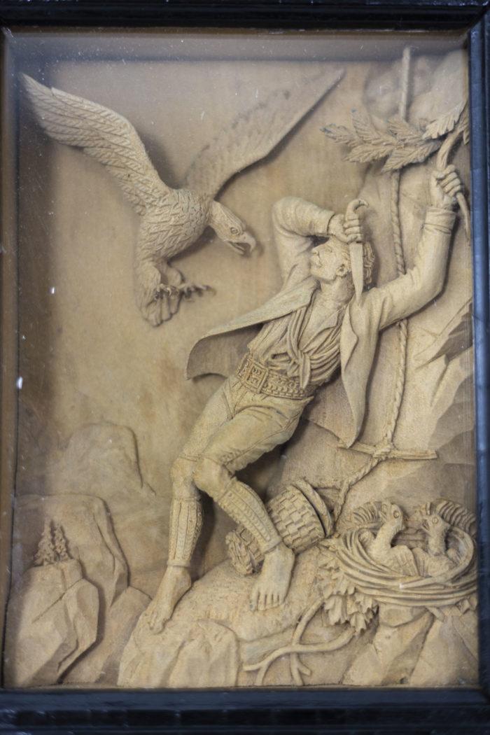 Tableaux en bois sculpté homme au couteau