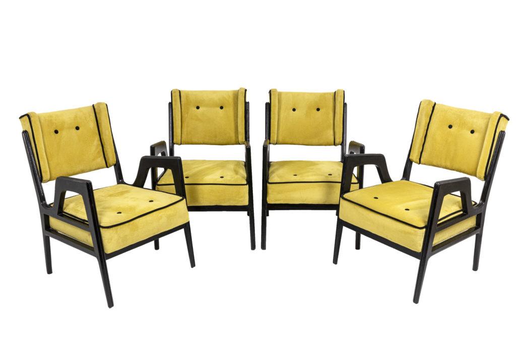 Série de quatre fauteuils à oreilles en bois laqué, années 1950