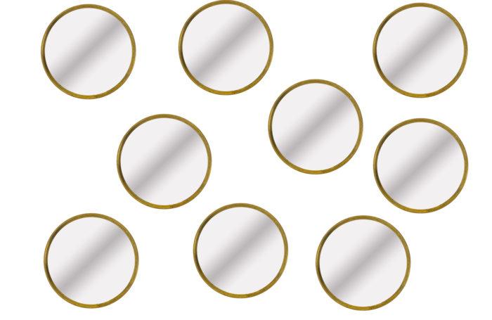 Série de neuf miroirs circulaires en laiton doré