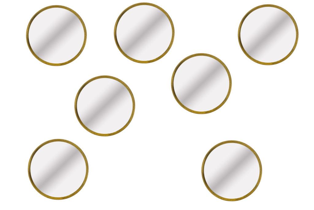 Série de sept miroirs en laiton doré, années 1970