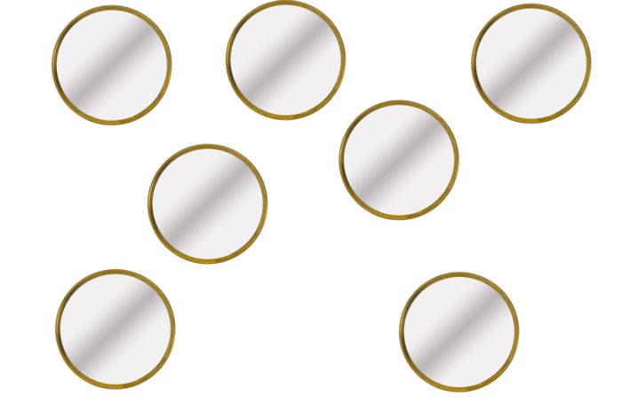 Série de sept miroirs circulaires en laiton doré