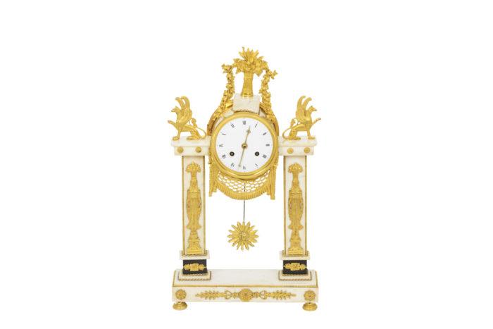 Pendule portique en bronze doré