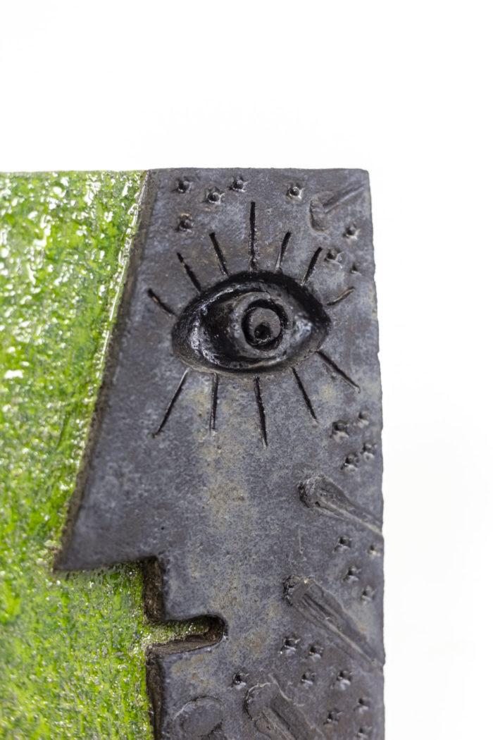 Pair of bas-reliefs- face