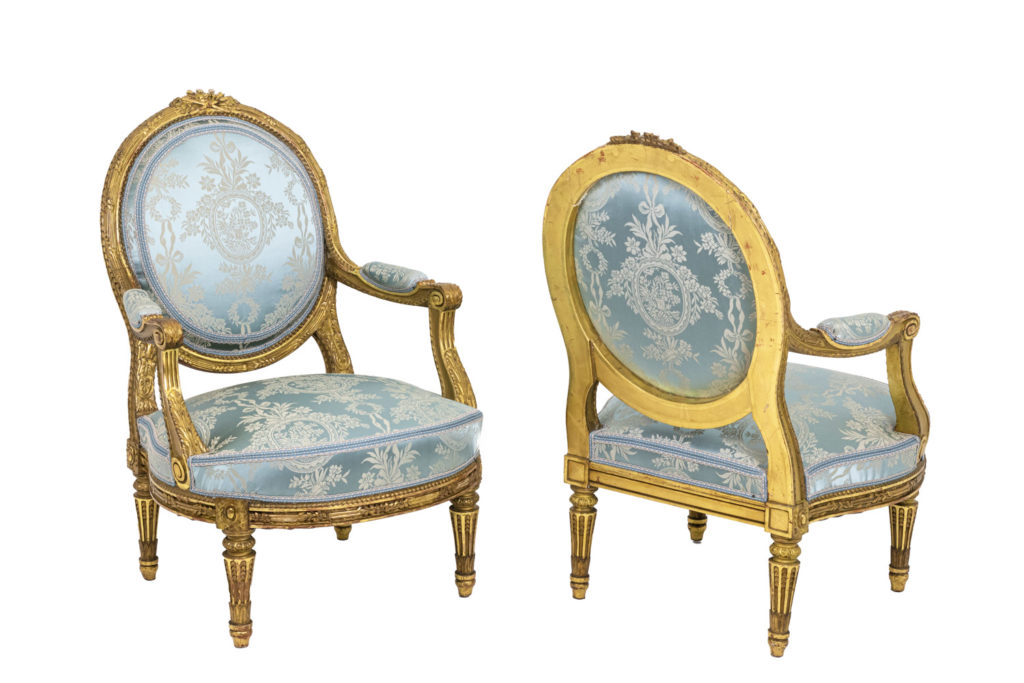 Pair of Louis XVI style armchairs in gilded wood, circa 1880