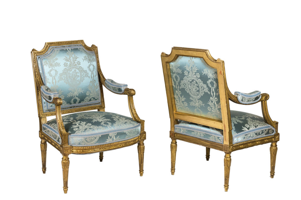 Pair of Louis XVI style armchairs in giltwood, circa 1880